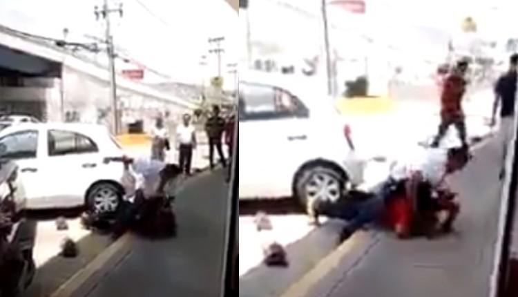 hombre golpea a sujeto que pateo a un perrito