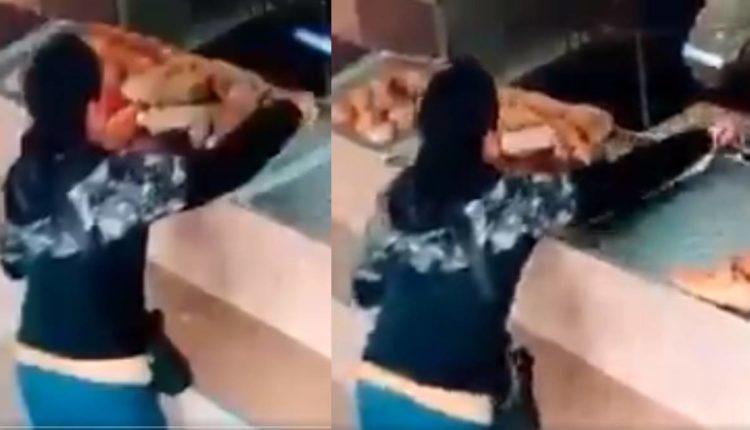 mujer roba celular panadería