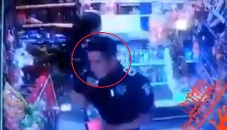 policía roba tiendita
