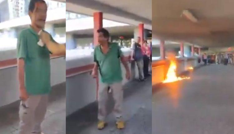 manifestantes fuego hombre